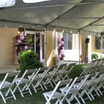Pink and Chocolate Balloon Columns with Tent and Chairs