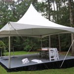 20 x 20 ft High Peak Tents and 20x20 Stage with Black Skirting