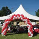 Tent with Red and White Balloon Arch