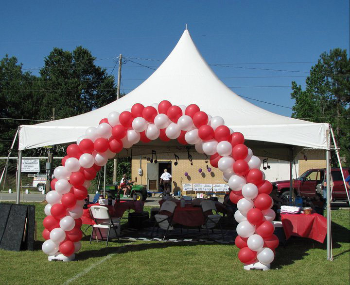 Tent With Red And White Balloon Arch Ring Party Rentals