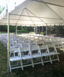 Tent with White Wooden Chairs